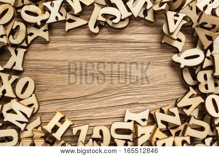 Frame made of letters of the alphabet made of wood with empty space for text