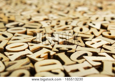 Close-up Letters of the alphabet made of wood for background
