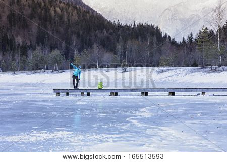 Active morning in the winter time. Exercise on the pier on the frozen lake. Active lifestyle - healthy lifestyle.