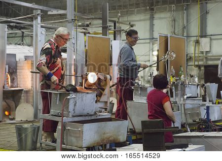 KARLOVY VARY CZECH REPUBLIC - SEPTEMBER 14 2014:Glass blowers demonstrate their craft a popular tourist attraction September 14 2014 in Karlovy Vary Czech Republic