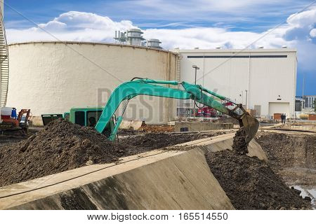 Construction Site construction machinery bulldozer excavation with power plant background