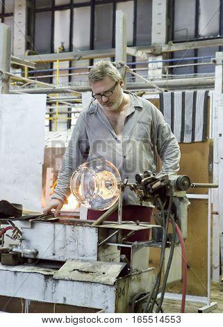 KARLOVY VARY CZECH REPUBLIC - SEPTEMBER 14 2014:Glass blowers demonstrate their craft a popular tourist attraction September 14 2014 in Karlovy Vary Czech Republic