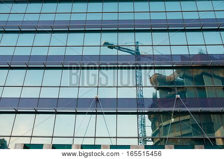 Construction building Reflection on mirror of tower