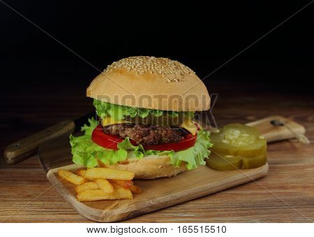 homemade hamburger with beef Patty and pickles