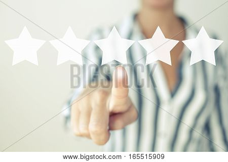 Rating stars increase rating review and evaluation concept with businesswoman