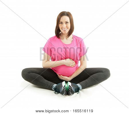 Pregnant young woman exercising isolated on white
