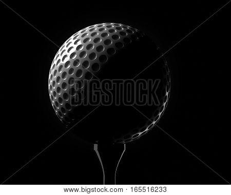 Golf ball on a tee isolated on black
