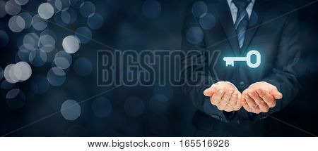 Businessman (consultant, coach, leader, customer service, CEO or another business person) offer key to success or solution. Turnkey solution and services concept. Right wide banner composition with bokeh in background.