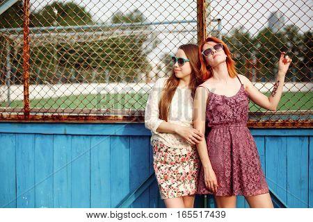 Two Teen Girls Posing Near The School Court