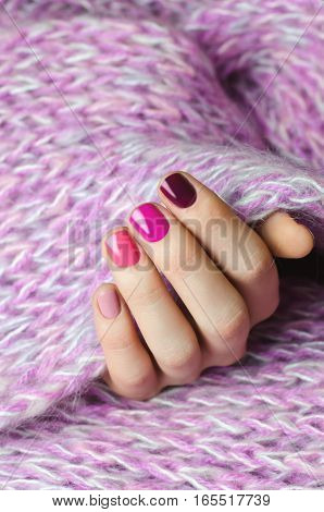 Beautiful female hand with pink nail design.
