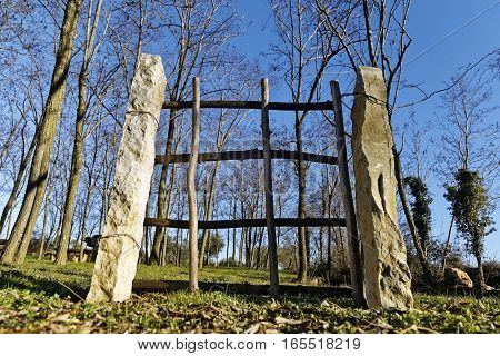 wooden gate in the nature under blue sky