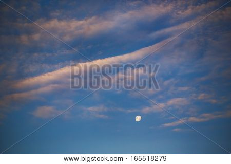 Evening Moon On The Blue Sky With Clouds