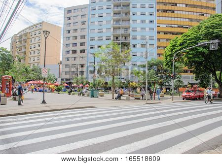 Londrina PR Brazil - December 23 2016: Downtown of Londrina. People walking between the downtown shops. Street called Calcadao destined to commerce and leisure.