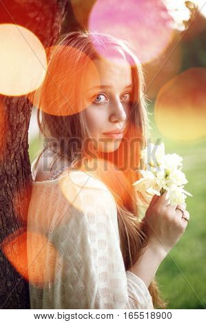 Portrait Of Young Romantic Woman With Spring Flowers