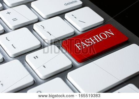 FASHION on Red Enter Button on white keyboard