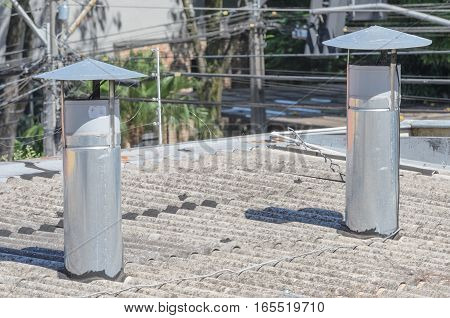 Heat extractor at the top of a restaurant roof.