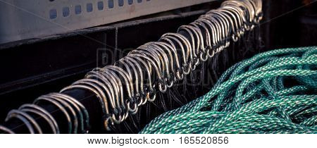 Row of mackerel fish hooks at a harbor in pei