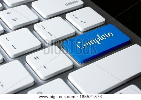 Complete word on blue enter computer keyboard