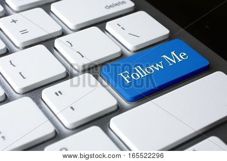 Follow Me  word on blue color enter keyboard