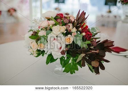 Flower arrangement wedding table. Decor flowers of table