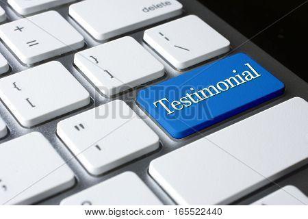 Testimonial  word on blue color enter keyboard