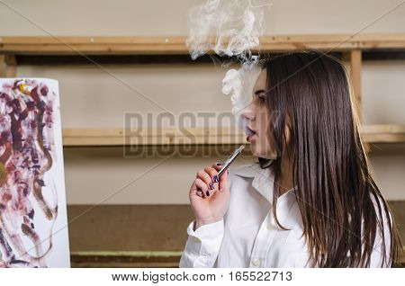 she let the smoke out of his mouth at the art studio