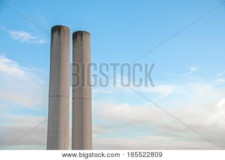 Cylindrical Concrete Columns Over Blue Sky Background