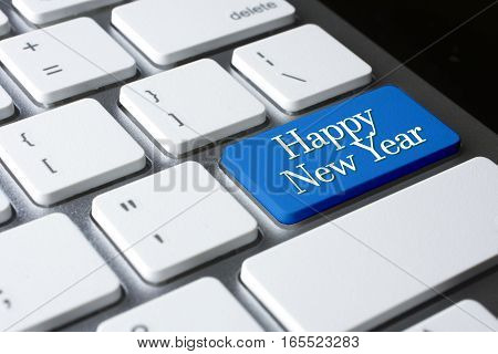 Happy New Year word on blue enter computer keyboard