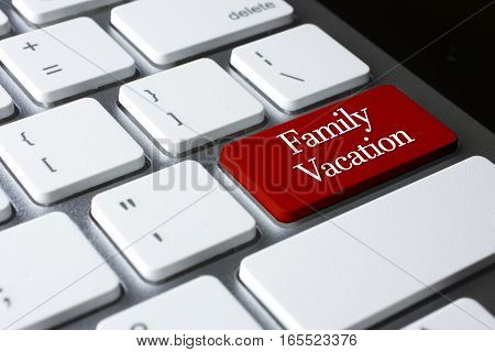Travel concept: Family Vacation on white keyboard