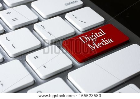 Advertising concept: Digital Media on white keyboard