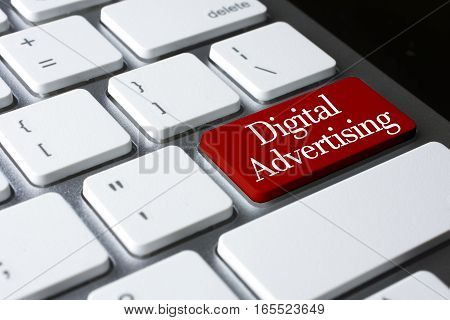Marketing concept: Digital Advertising on white keyboard