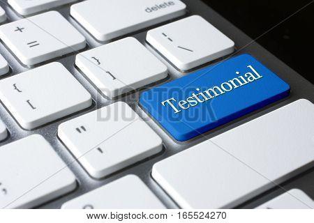 Testimonial word on blue enter computer keyboard