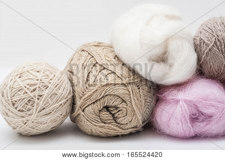 Multicolor wool balls of wool on grey background