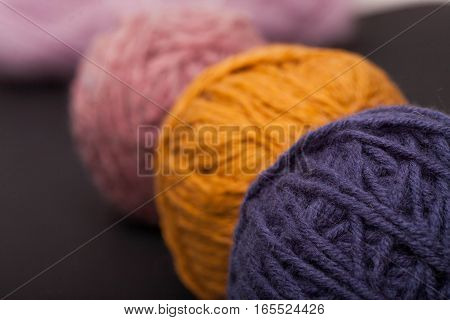 Multicolor wool, balls of wool on black background