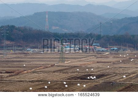 Landscape of farmland and small community in Korea after the fall harvest