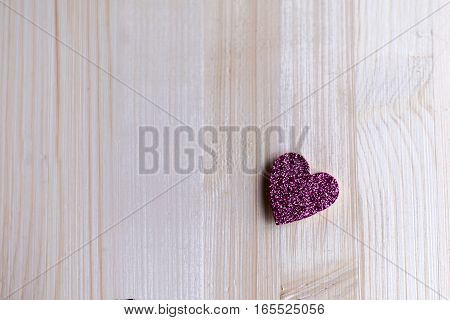 One tender pink heart are at a distance from each other on Valentine's Day, Valentine's Day, on a wooden background
