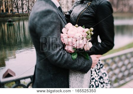 A girl and a guy hug each other