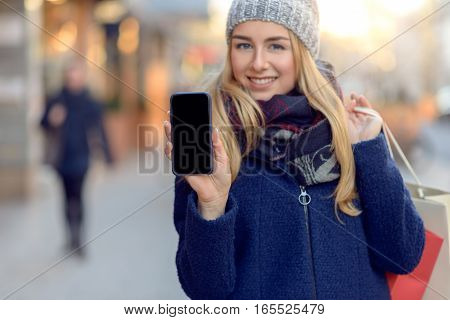 Pretty Young Woman Holding Up Her Mobile