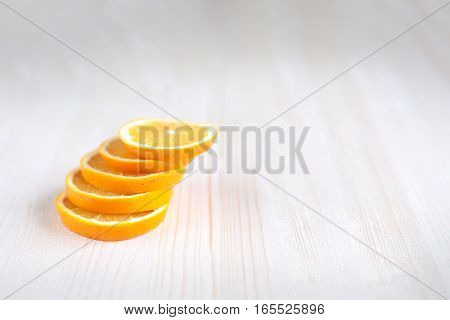 Orange sliced slices piled into the turret of the slices of orange on wooden boards