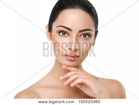 Beautiful thoughtful indian girl with perfect skin make up closeup. Beauty and health care. Ideal portrait of brunette, isolated on white background