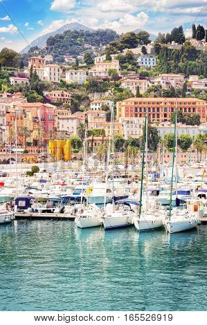 colorful houses and yachts in Menton old town harbour, France, retro toned