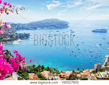 landscape of riviera coast, turquiose water and blue sky of cote dAzur at sunny summer day, France, toned