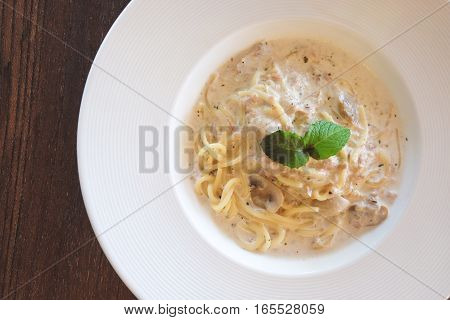 Close up of Spaghetti cream sauce tuna and mushroom in soft vintage tone