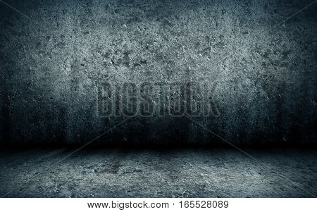 abstract grunge interior of an empty gloomy abandoned room with a concrete floor and walls