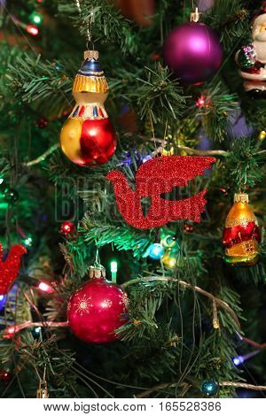 Beautiful decorations close up on faux Christmas tree