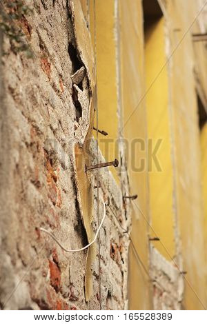 Yellow plaster falling off in Venice - Italy