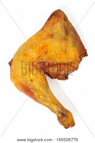 a grilled chicken leg isolated over white