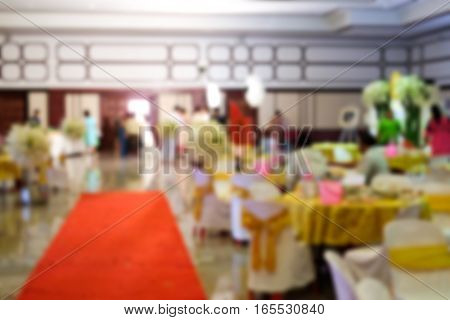 Blur image at wedding ceremony in large hall