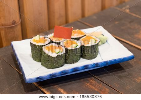 Homemade sushi with salmon cream cheese Philadelphia Japanese. selective focus and warming tone