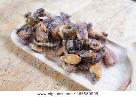 Thai style crispy fried squid on wood tray